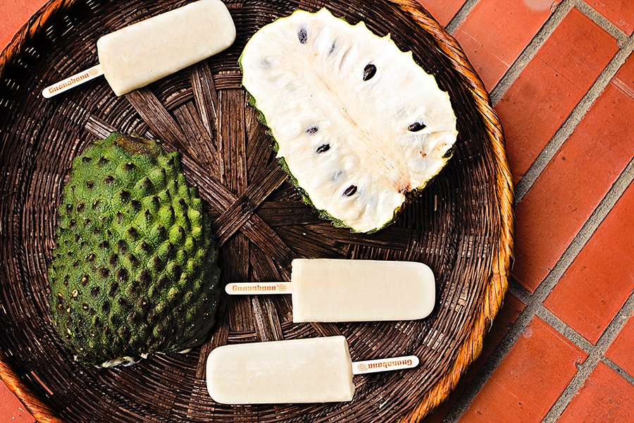 soursop cut in half with soursop ice pops