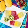 three colored ice pop with assortment of fresh fruit