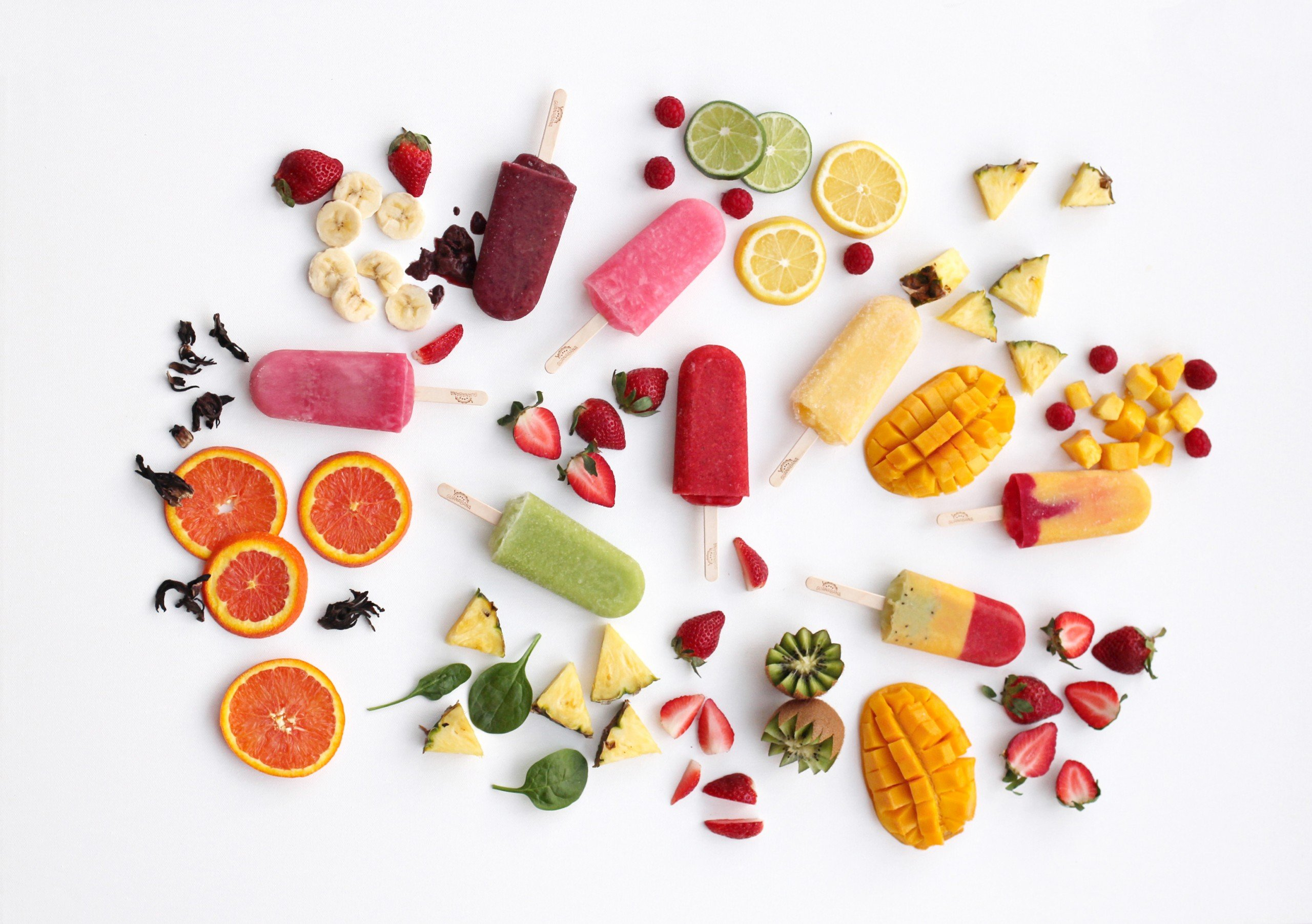 colorful fresh ice pop and fruit assortment