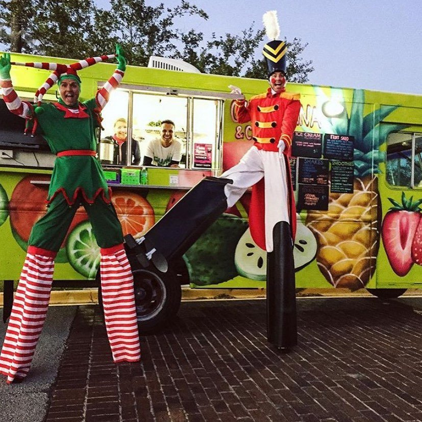 christmas Elf on stilts at food truck